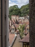Edinburgh, Scotland, the UK - old houses and trees. This image shows a view of some of the old buildings in Edinburgh, Scotland, the UK. It was taken on a sunny stock photo
