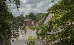 Edinburgh, Scotland, the UK - roofs and trees. This image shows a view of some old buildings in Edinburgh, Scotland, the UK. It was taken on a sunny day in July stock photo