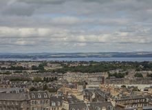 Edinburgh, Scotland - a view from Calton Hill - buildings, sky and the sea. This image shows a view of the old town in Edinburgh, Scotland. It was taken on a royalty free stock photography