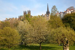 EDINBURGH, SCOTLAND: View of Princes Street Gardens with spring colors Genius of Architecture Statue in the foreground. View of Princes Street Gardens with stock photography