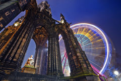 Edinburgh, Scott monument at night. Horizontal colour image of Scott Monument and russian wheel in the background, Edinburgh, Scotland Stock Photo