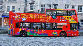 Edinburgh sightseeing, Scotland (UK). Edinburgh, Scotland - December 23, 2015: Tourists embark the sightseeing tour of landmarks  in Edinburgh, Scotland, UK Stock Photography