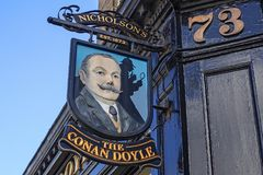 Edinburgh, Sign at the Conan Doyle pub. EDINBURGH, SCOTLAND - JULY, 16, 2017: Sign of the well-known Conan Doyle Pub in Edinburgh, named after Sir Arthur Conan Royalty Free Stock Images