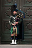 Edinburgh street bagpiper Stock Photo