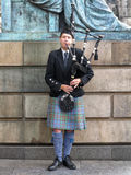 Edinburgh street bagpiper Royalty Free Stock Photo