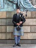 Edinburgh street bagpiper Royalty Free Stock Photo