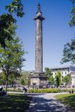 Edinburgh, United Kingdom. 16th May 2018 : Sun-lovers relaxing i. N St Andrew square garden. The column is the Melville Monument commemorating Henry Dundas, the stock photos