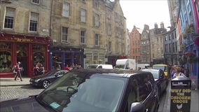 Edinburgh West Bow and Grass Market, in the Old Town, Edinburgh, Scotland. Edinburgh West Bow and Grass Market with colorful shops in the Old Town, Edinburgh stock footage