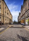 Edinburghs cobbled streent in the morning time Royalty Free Stock Photography
