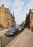 Edinburghs streets in evening sunny rays Royalty Free Stock Image