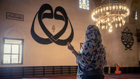 Edirne, Turkey - April 19, 2014: A women praying at The Old Mosque Eski Cami in Edirne. A women praying at The Old Mosque Eski Cami in Edirne Stock Image