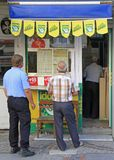 People are waiting in line at shop with lottery tickets Stock Images