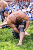 EDIRNE, TURKEY - JULY 06, 2013: Wrestler getting ready before competition in traditional Kirkpinar wrestling. Kirkpinar is a Turki Stock Images