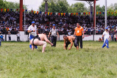EDIRNE, TURKEY - JULY 26, 2010: Wrestlers Turkish pehlivan and Japanese sumo wrestler at the competition in Kirkpinar. Kirkpinar i Stock Photos