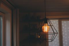 Edison lamp in vintage style lighting in evening home interior. Earth hour and energy save concept royalty free stock images