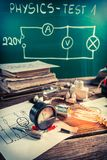 Edison light bulb, electrical components and diagrams in classroom Royalty Free Stock Photography