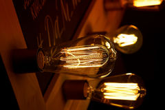 Edison light bulb hanging on a long wire. Cozy warm yellow light.Retro Royalty Free Stock Photography