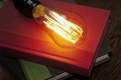 Edison Lightbulb Books Royalty Free Stock Photos