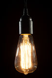 Edison ljus kula på träbakgrund arkivfoto