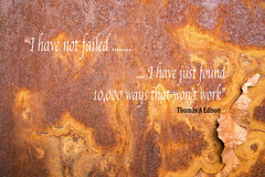 Edison motivational quote. Motivational quote from Thomas Edison on rusting metal background stock illustration