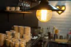 Edison`s light bulb and lamp in modern style coffee shop. warm tone photo Stock Image