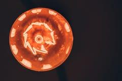 Edison`s light bulb. Orange edison`s light bulb in the dark. Top view stock images