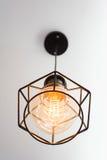 Edison`s lightbulb in interior. Edison`s light bulb and lamp in modern style. Warm tone light bulb lamp. Lamps in coffee shop. Edison`s lightbulb in interior stock photo