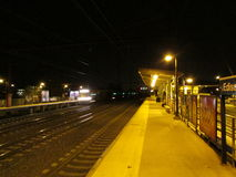 Edison train station platform with approaching train on the left and Edison sign on the right. Royalty Free Stock Photo