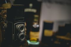 Still life of vintage camera. Edit color tone  focus on camera with blurred background , for nostalgia concept , still life of vintage film camera Royalty Free Stock Photography