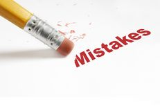 Edit mistakes red. Closeup of pencil eraser and red Mistakes text Stock Image