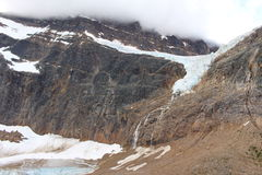 Edith Cavell angel glacier. The hanging Angel Glacier is visible from Cavell Meadows. pills over a 300 metres (984 ft) cliff on the north face stock photography