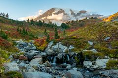Edith Creek with Mt. Rainier in Fall. Edith Creek with Mt. Rainier covered in changing foliage in Fall stock images