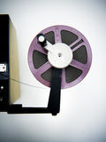 Editing machine and purple 8mm reel Royalty Free Stock Photography