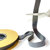 Editing. Scissors cut a tape on a white background Royalty Free Stock Images