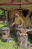 21 edition of Medieval Market of Etterbeek. BRUSSELS, BELGIUM-MAY 19, 2013: Blacksmith shows his art during activities of 21 edition of Medieval Market of Royalty Free Stock Photography