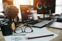 Free Editor Desk Equipment And Form Storyboard Laptop And Camera Editor Content Online Royalty Free Stock Photos - 173797448
