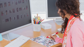 Editor marking the contact sheet Royalty Free Stock Images