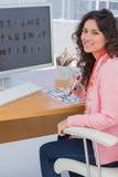 Editor marking the contact sheet and looking at camera Royalty Free Stock Photography