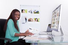 Editor using digital tablet at photo agency Royalty Free Stock Photography