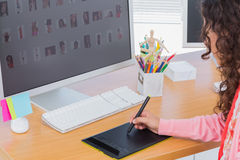 Editor using graphics tablet to edit Stock Photography