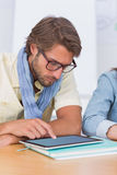 Editor using tablet at meeting Royalty Free Stock Images