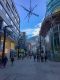 Editorial. Andorra la Vella, Andorra, 20 January 2018, People shopping in a comercial street in Andorra stock photography