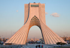 Editorial Azadi square. Azadi monument, the famous landmark of Tehran with bunch of people in front of it stock photos