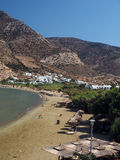 Editorial beach in Kamares Sifnos Greece. SIFNOS, GREECE-SEPT. 15: The beach in Kamares, port town of Sifnos Island, Greece is seen with typical Cyclades Stock Photo