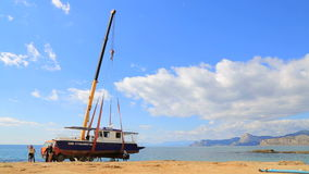 EDITORIAL. Big Sailboat Being Moved On The stock video footage