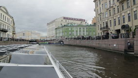 Editorial-The boat goes through the channel in center St.Petersburg,the riverbus. ST PETERSBURG, RUSSIA - 10 Sep 2016. The boat goes through the channel in stock footage