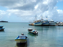 Editorial boats Brig Bay Corn Island Nicaragua. CORN ISLAND, NICARAGUA-MARCH 13: Commericial fishing boats and private boats are seen in Caribbean Sea in Brig Royalty Free Stock Image