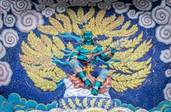 Editorial Buddha temple with mosaic. 26 May 2014,Nakorn Rajasima ,Thailand : fantasy art angle shape with mosaic at Baan Rai BUddha temple Stock Image