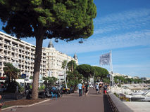 Editorial Cannes tourists on Promenade de la Croisette. CANNES-SEPT. 13: Tourists walk along famous Promenade de la Croisette in front of historic Carlton Hotel Royalty Free Stock Photography