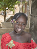 Editorial caption: M'Bao, Senegal, Africa – August 6, 2014: Child in the street on a feast day Royalty Free Stock Photo